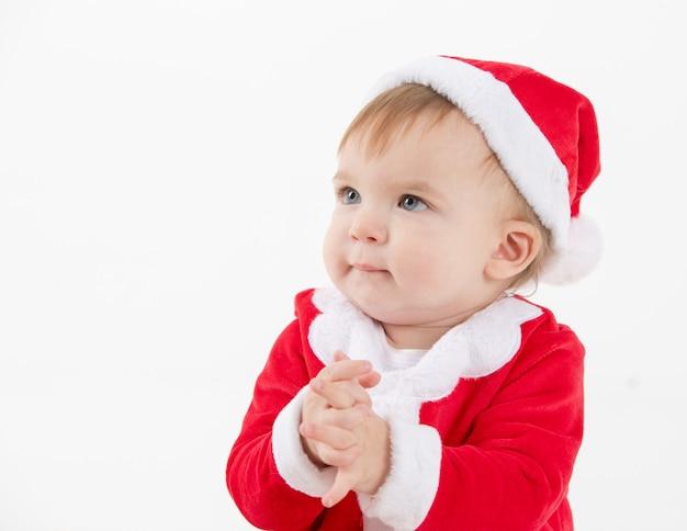 握手サンタクロースに扮した赤ちゃん