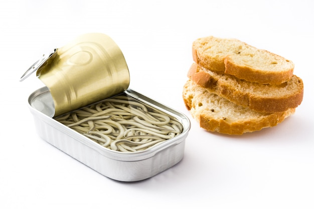 Baby eel can preserve and toast bread isolated