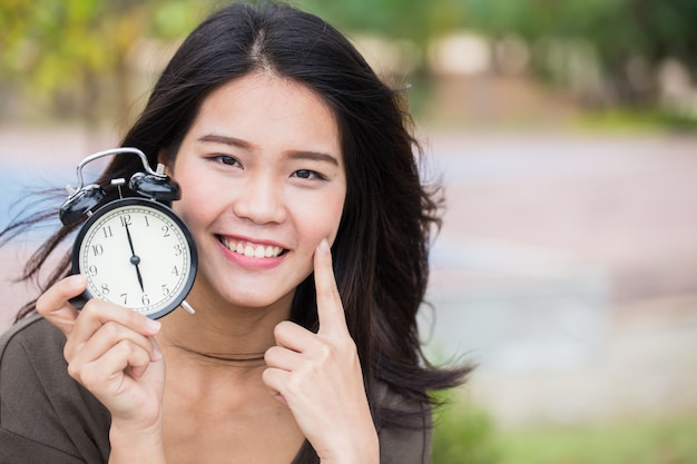 Baby face time, timeless cute asian women girl with young skin look with clock time