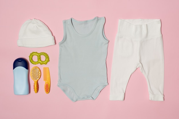 Baby fashion  on a pink . clothing and accessories for care.