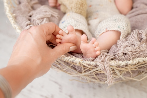 Baby feet in mother hands. tiny newborn baby's feet on female shaped hands closeup. mom and her child. happy family concept. beautiful conceptual image of maternity