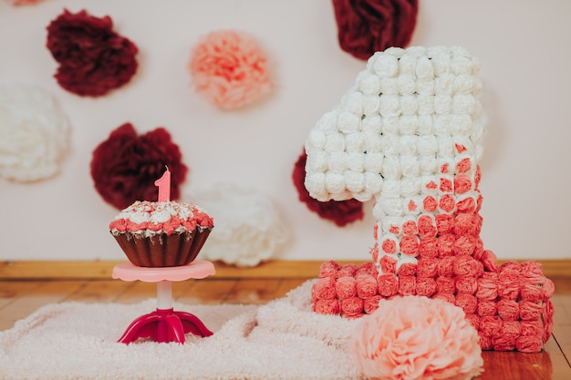 Baby first birthday party. focus on cake with candle