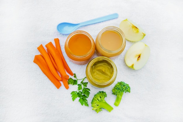 Baby food. mashed vegetables and fruits in jars