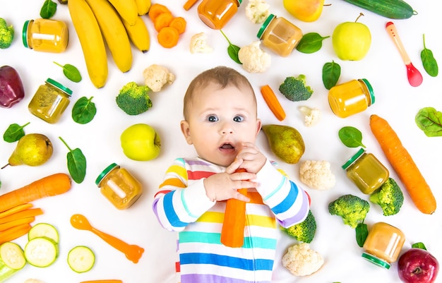 Baby food puree with vegetables and fruits. selective focus. nutrition.