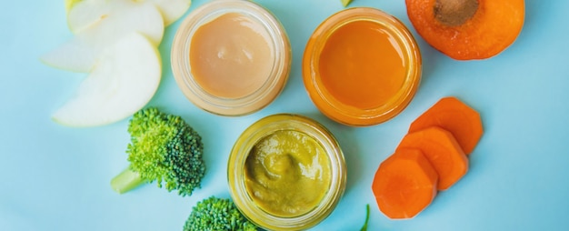 Baby food in small jars. selective focus.