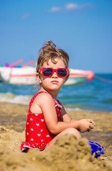 Baby girl on the beach, by the sea. selective focus.