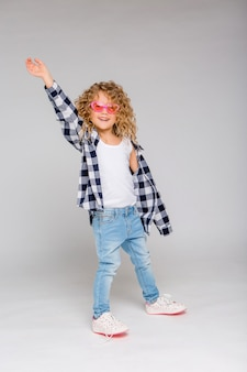Baby girl blonde girl in pink glasses smiling