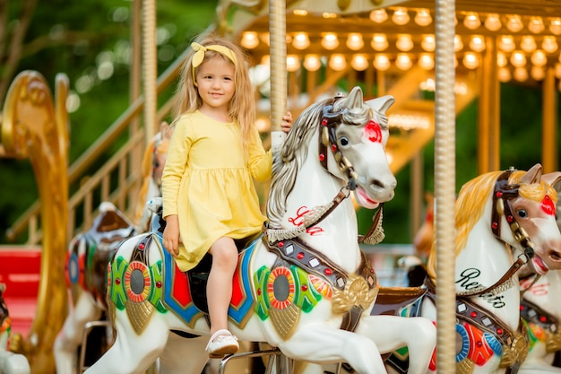 Baby girl on the carousel
