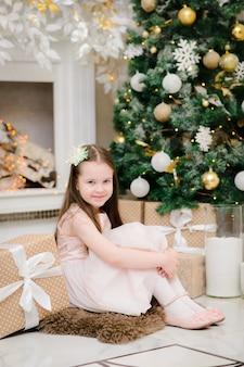 Baby girl in christmas interior