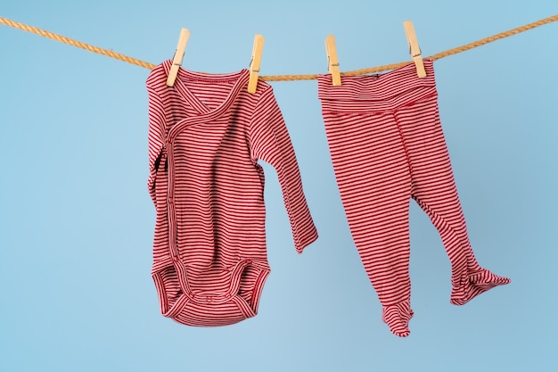 Baby girl clothes pinned on a clothesline