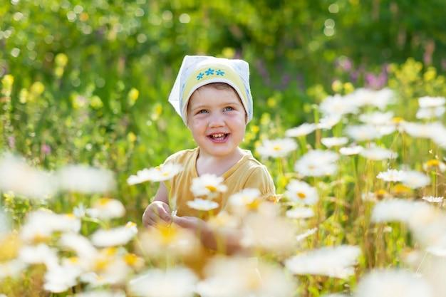 Baby girl in daisy meadow