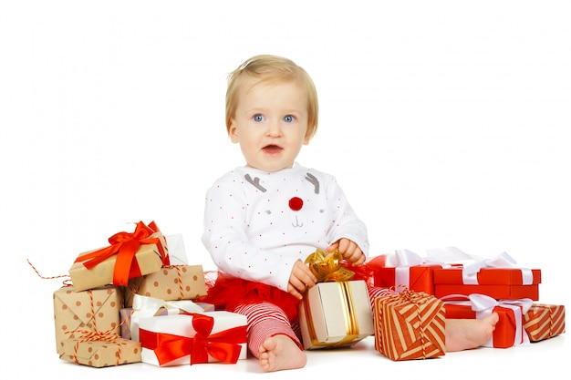 Baby girl and gift isolated on white