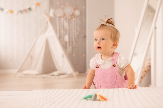 Baby girl in the nursery playing