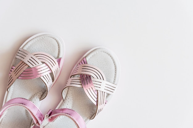 Baby girl pink sandals isolated on background. baby fashion pair pink sandals shoes for the toddlers feet .