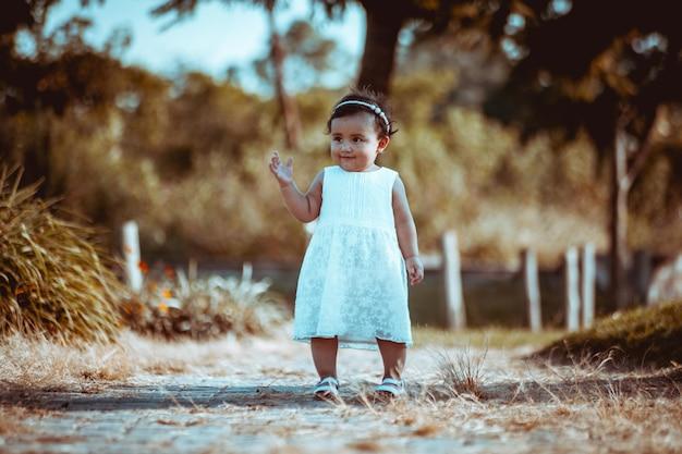 Baby girl playing at park
