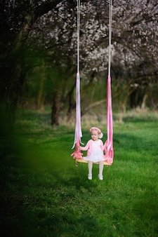Baby girl ride on a swing
