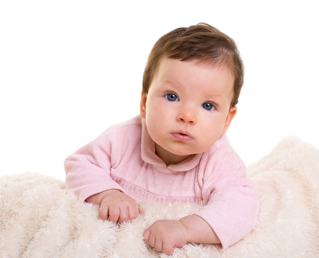 Baby girl smiling  in pink with winter white fur blanket