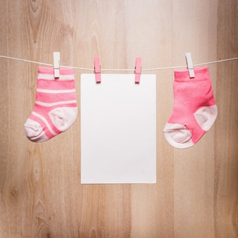 Baby girl socks attached to the rope and blank card