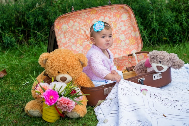 Baby girl in suitcase