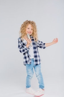 Baby girl with microphone smiling singing