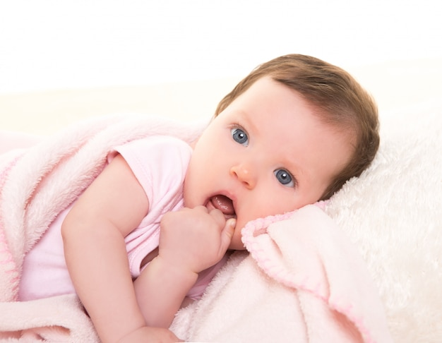 Baby girl with toothache in pink with white fur