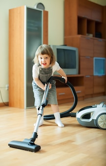 Baby girl with vacuum cleaner