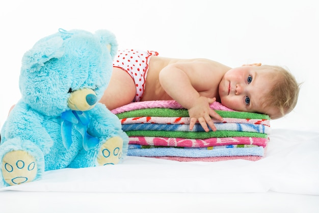 Baby is on colourful towels