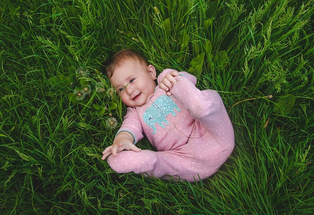 Baby is lying on the grass. selective focus. nature.