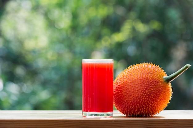 Baby jackfruit, gac fruit with baby jackfruit juice on blurred.