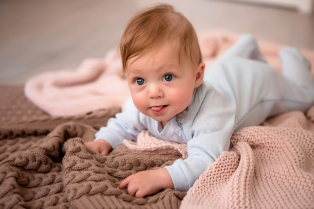Baby on a knitted blanket