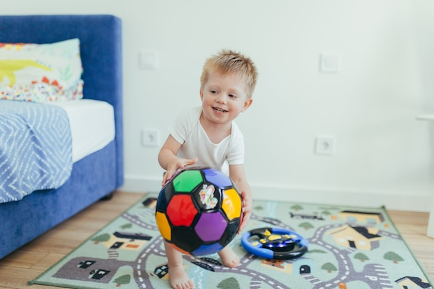 Baby little boy playing in his room