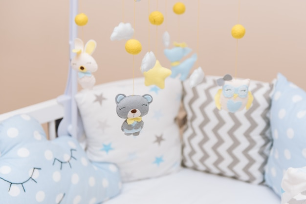 Baby mobile with different toys in the form of animals and stars