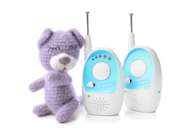 Baby monitor units and toy on white . radio nanny