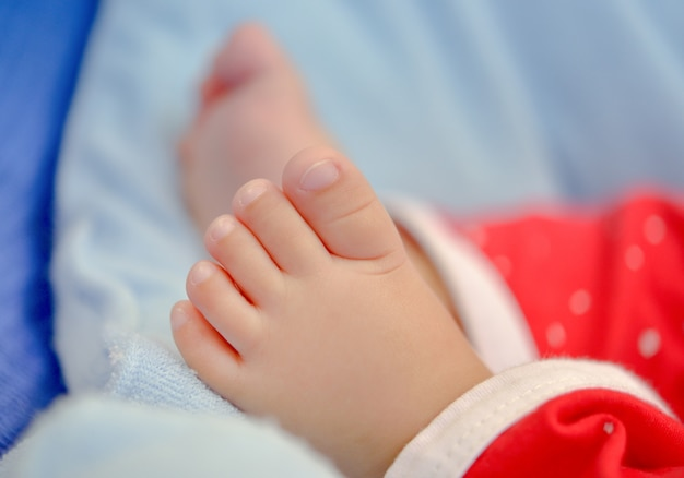 Baby newborn feet, new born kid foot