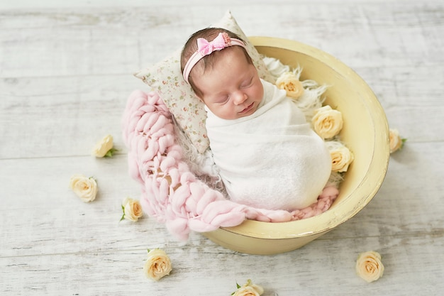 Baby newborn girl on a light background