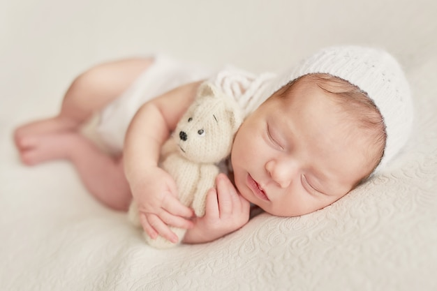 Baby newborn girl on a light background