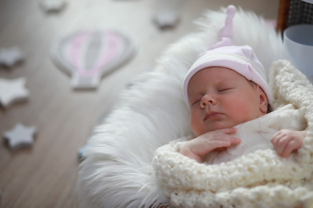 Baby newborn sleeping wrapped up in a warm blanket