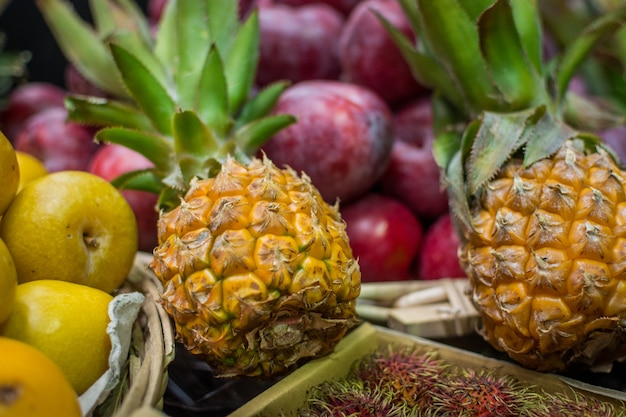 Baby pineapples at market