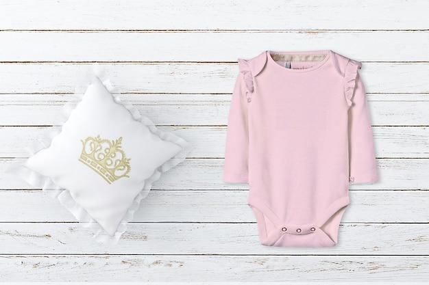 Baby pink bodysuit mockup pillow mockup
