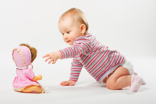 Baby playing with doll