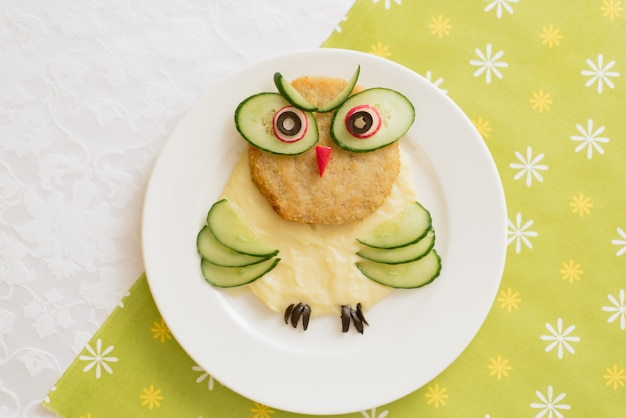 Baby puree in the shape of an owl. mashed potatoes.