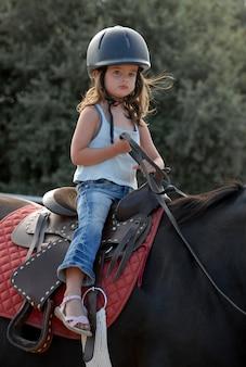 Baby riding girl