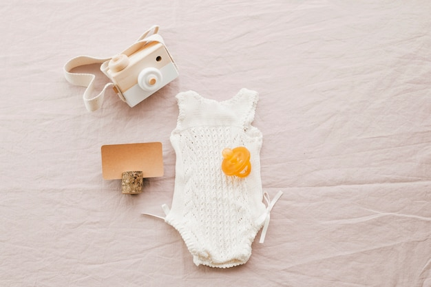 Baby romper and toy camera