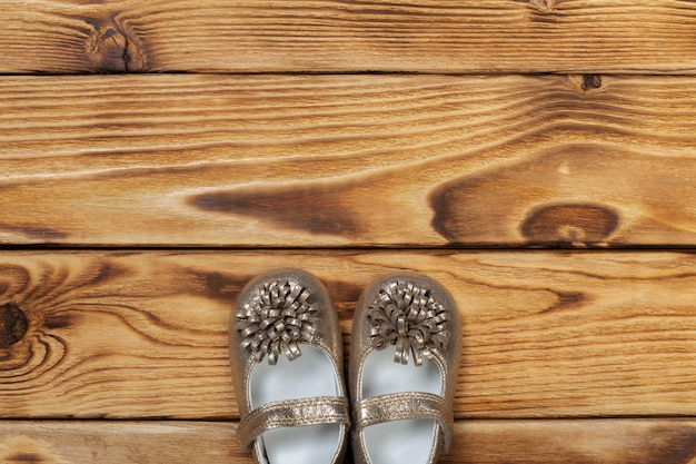 Baby's bootee on wooden