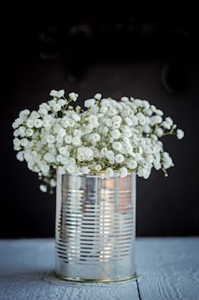 Baby's breath (gypsophilia paniculata) in old grunge vase on black background