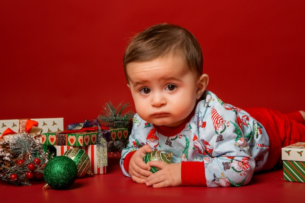 Baby santa on red background, space for text