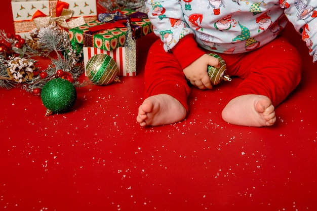 Baby santa with christmas gifts or presents