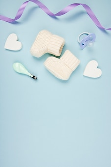 Baby shoes and hearts close up