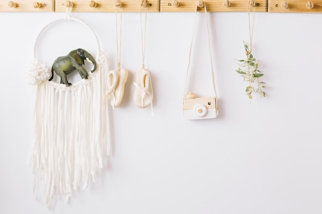 Baby-shoes, toy camera and nursery decorations