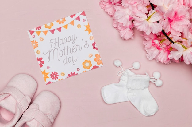 Baby shoes with card and flowers for mothers day